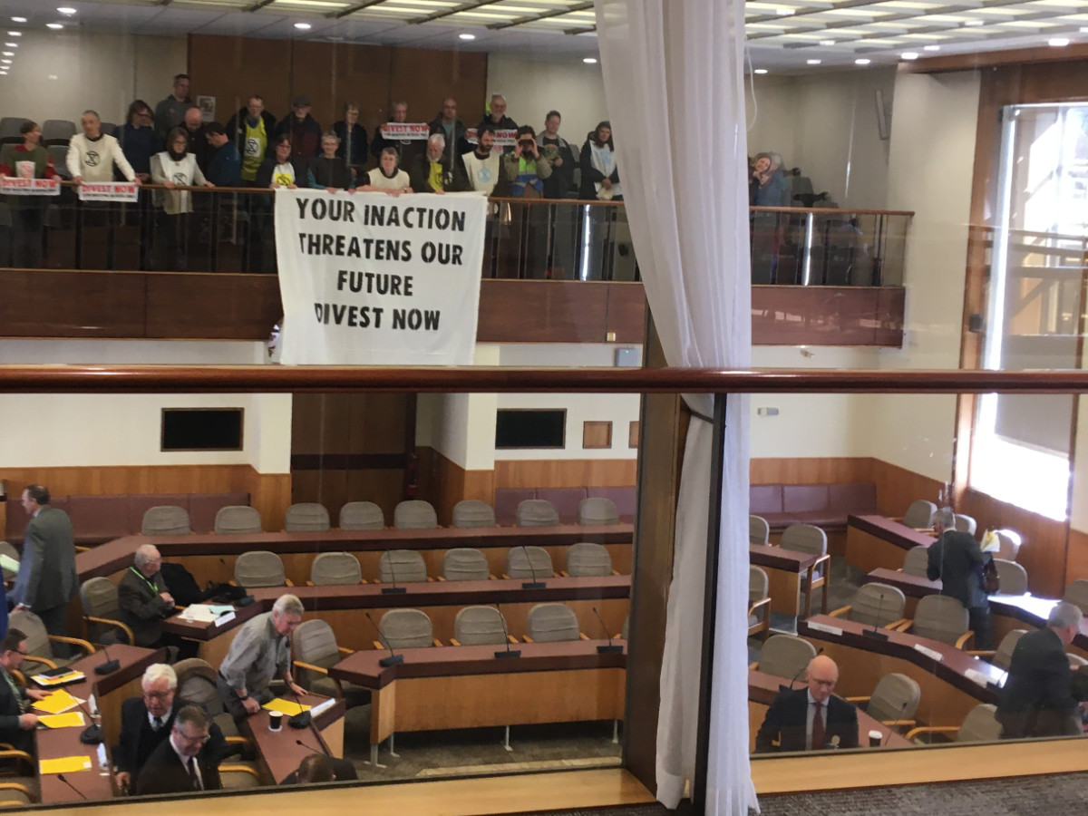 banner drop over balcony at pension fund meeting