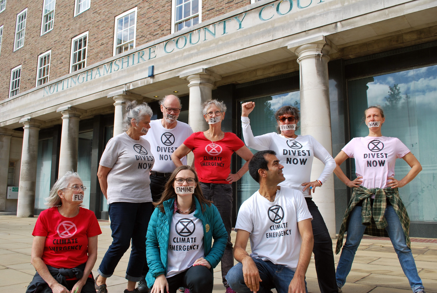Rebels in Divest Now t-shirts