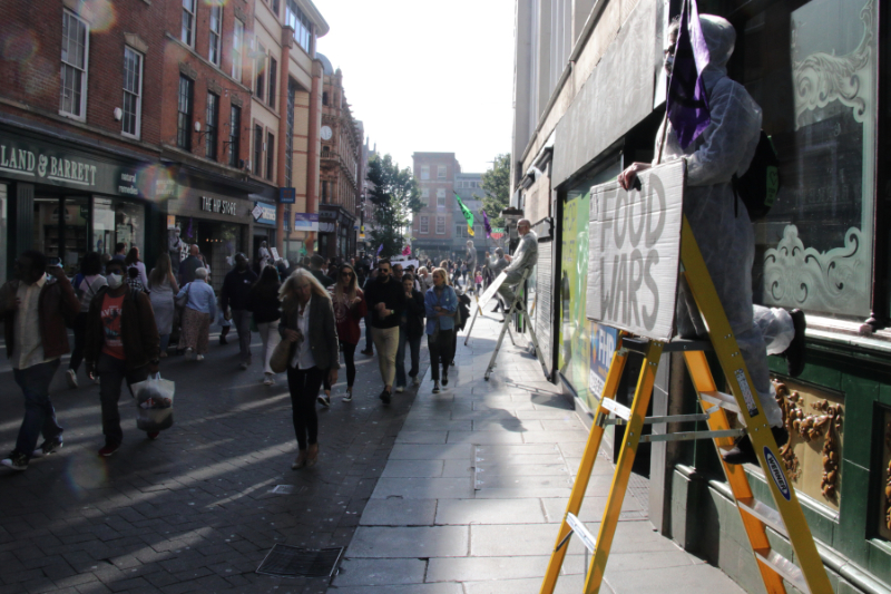 view of clumber st shoppers and rebels on ladders
